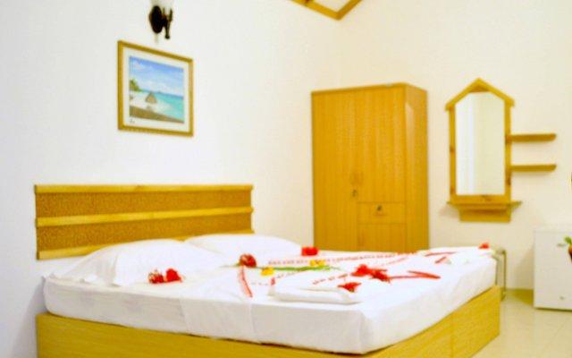 Отель Holiday Cottage Мальдивы, Северный атолл Мале - отзывы, цены и фото номеров - забронировать отель Holiday Cottage онлайн комната для гостей