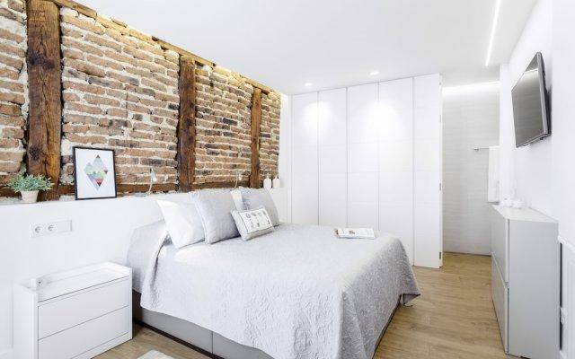 Отель Santa Ana Apartment by FlatSweetHome Испания, Мадрид - отзывы, цены и фото номеров - забронировать отель Santa Ana Apartment by FlatSweetHome онлайн комната для гостей