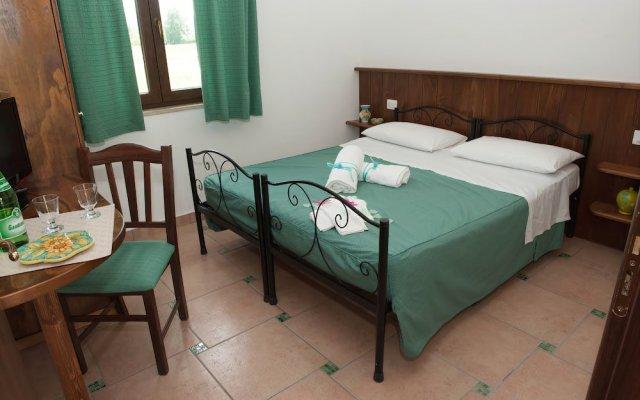 Отель L'Oasi del Fauno Country House Казаль-Велино комната для гостей