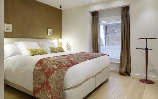 Отель Hika Mika Apartment by FeelFree Rentals Испания, Сан-Себастьян - отзывы, цены и фото номеров - забронировать отель Hika Mika Apartment by FeelFree Rentals онлайн комната для гостей