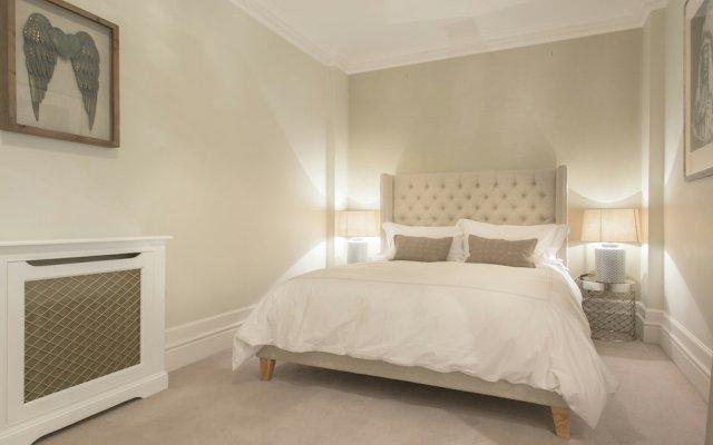 Апартаменты The Luxe Whitehall Duplex Apartment комната для гостей