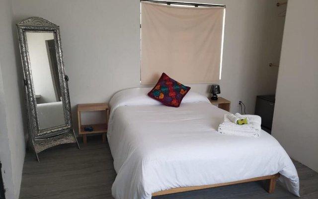 Отель Hermila Tlalpan Suites Мехико комната для гостей