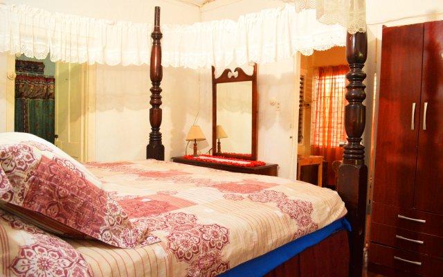 Отель Cottages Dead End Beach Road комната для гостей