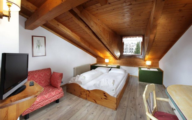 Отель Centro Vacanze Veronza Clubresidence Карано комната для гостей