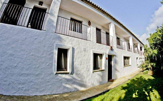Отель Hacienda Roche Viejo Испания, Кониль-де-ла-Фронтера - отзывы, цены и фото номеров - забронировать отель Hacienda Roche Viejo онлайн вид на фасад