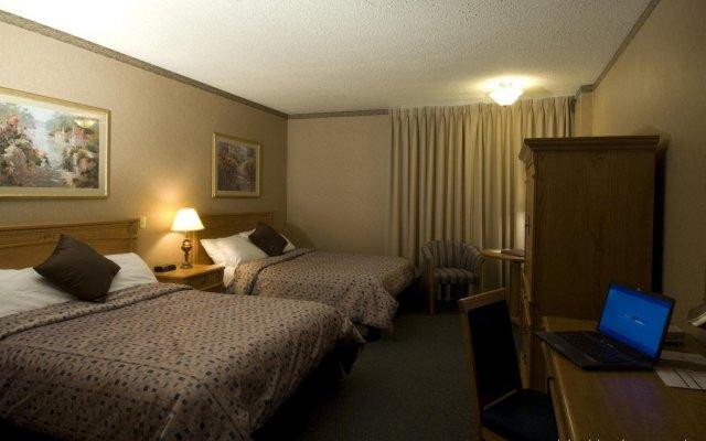 Отель The Glenmore Inn & Convention Centre Канада, Калгари - отзывы, цены и фото номеров - забронировать отель The Glenmore Inn & Convention Centre онлайн комната для гостей
