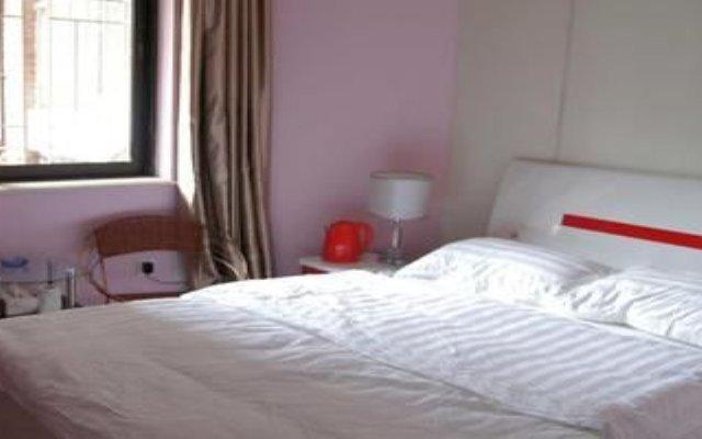 Отель Gulangyu Lianhe Apartment Hotel - Xiamen Китай, Сямынь - отзывы, цены и фото номеров - забронировать отель Gulangyu Lianhe Apartment Hotel - Xiamen онлайн комната для гостей