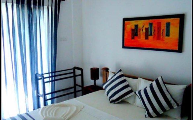 Отель Mermaid Bay Maggona комната для гостей