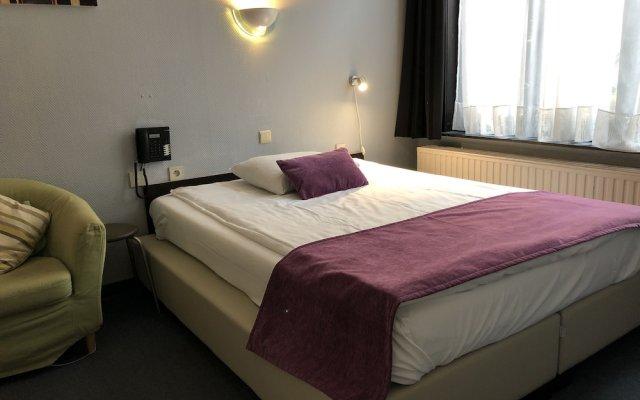 Отель Montovani Брюгге комната для гостей