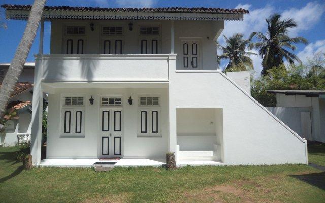Отель Chitra Ayurveda Hotel Шри-Ланка, Бентота - отзывы, цены и фото номеров - забронировать отель Chitra Ayurveda Hotel онлайн вид на фасад