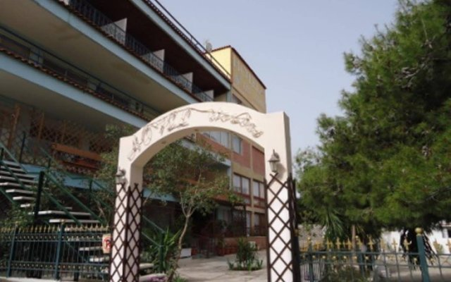 Отель Les Amis Греция, Вари-Вула-Вулиагмени - отзывы, цены и фото номеров - забронировать отель Les Amis онлайн вид на фасад