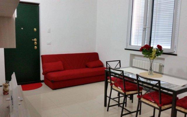Отель Grazioso Appartamento Genziane Генуя комната для гостей