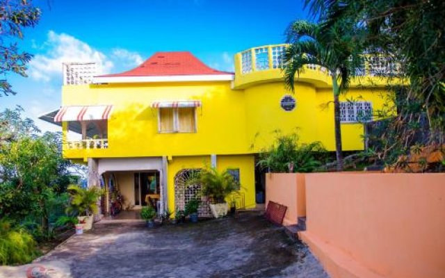 Отель Ackee Tree Sea View Villa Ямайка, Порт Антонио - отзывы, цены и фото номеров - забронировать отель Ackee Tree Sea View Villa онлайн вид на фасад