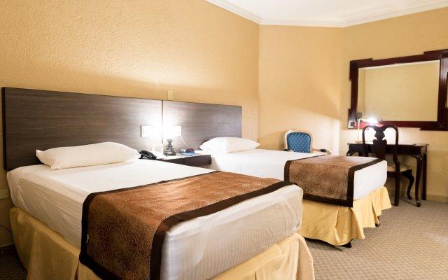 Отель Copantl Convention Center Сан-Педро-Сула комната для гостей