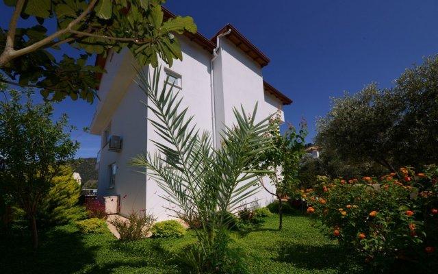 Отель Villa Mercan 1 by Akdenizvillam Калкан вид на фасад