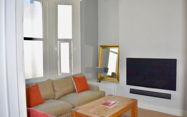 Отель 1 Bedroom Home in Central Brighton Брайтон комната для гостей