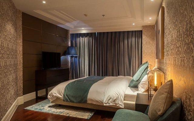 Отель Lagom Bright House Sea View Apartment Китай, Сямынь - отзывы, цены и фото номеров - забронировать отель Lagom Bright House Sea View Apartment онлайн комната для гостей