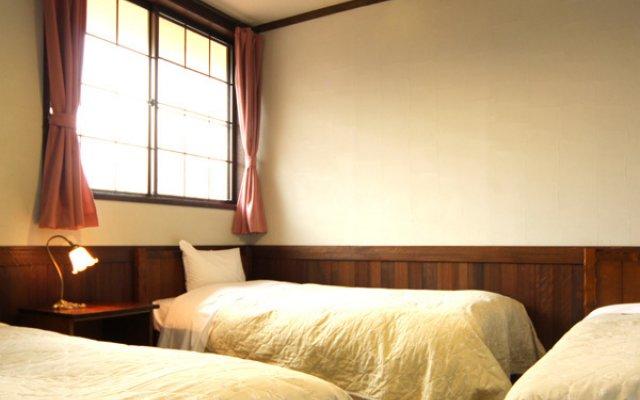 Отель Stone House Inn Camello Минамиогуни комната для гостей