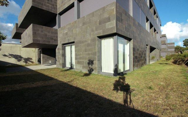 Апартаменты Deluxe Populo Beach Apartments вид на фасад