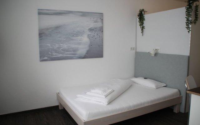 Отель DasApartmentHaus - Zentrum-Fürstenplatz комната для гостей
