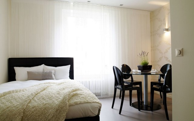 Отель VISIONAPARTMENTS Zurich Waffenplatzstrasse комната для гостей