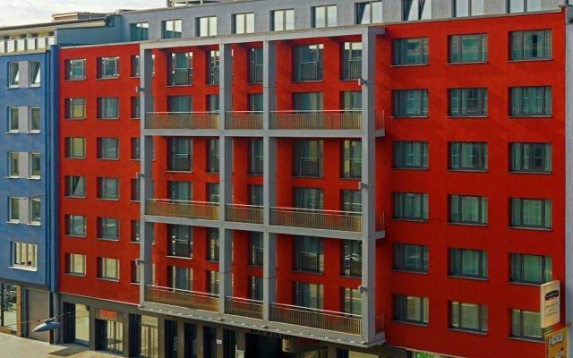 Отель Courtyard by Marriott Munich City Center вид на фасад