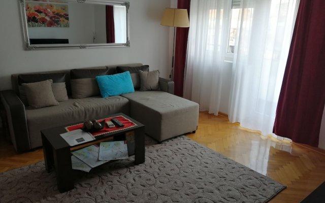 Апартаменты Panorama Central Apartments комната для гостей