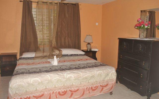 Отель Enchanted Villas and Guest House комната для гостей