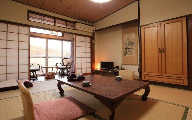 Отель Shironoi Япония, Минамиогуни - отзывы, цены и фото номеров - забронировать отель Shironoi онлайн комната для гостей