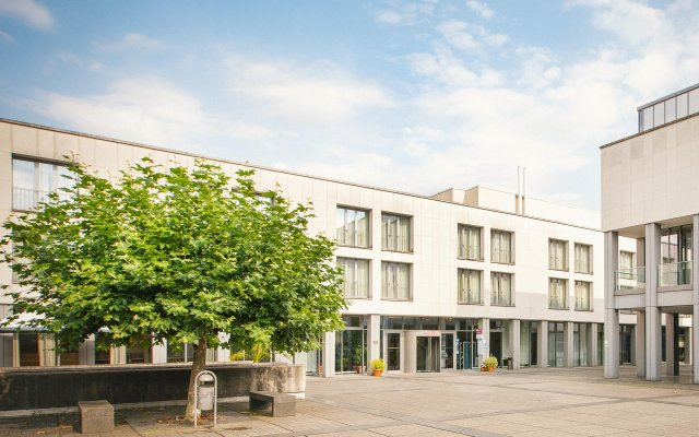 Отель Vienna House Easy Trier вид на фасад