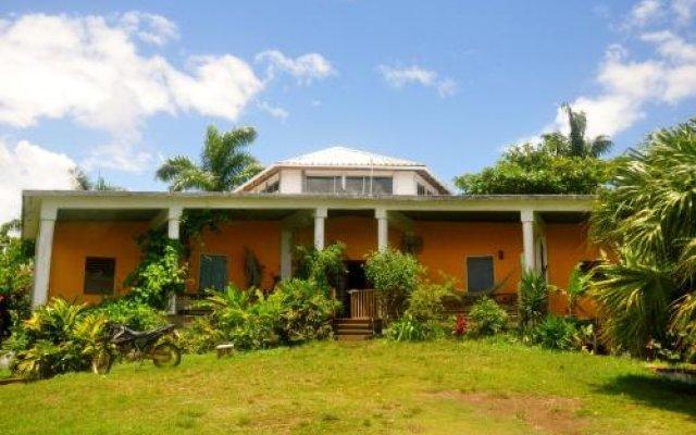 Отель Germaican Hostel Ямайка, Порт Антонио - отзывы, цены и фото номеров - забронировать отель Germaican Hostel онлайн вид на фасад