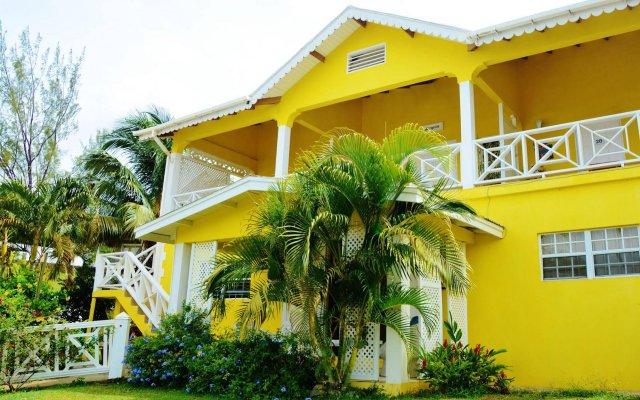Отель Beachcombers Hotel Сент-Винсент и Гренадины, Остров Бекия - отзывы, цены и фото номеров - забронировать отель Beachcombers Hotel онлайн вид на фасад