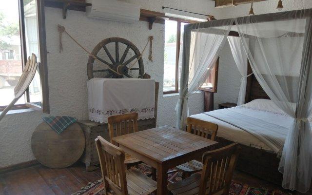 Отель Priamos Pansiyon Тевфикие комната для гостей
