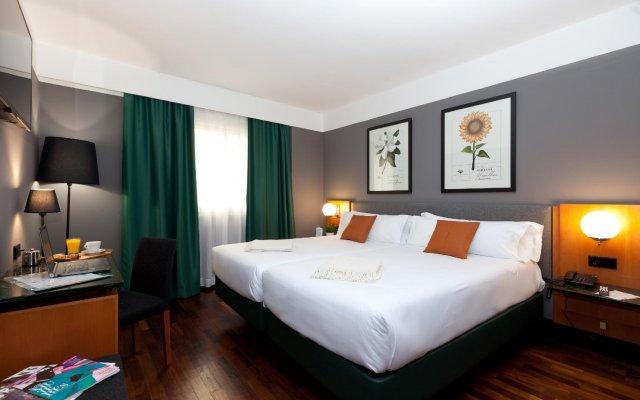 Отель Malcom and Barret Валенсия комната для гостей