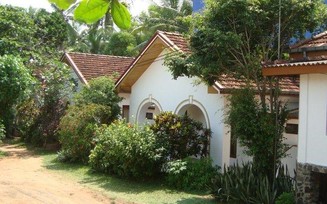 Отель The Tandem Guesthouse Шри-Ланка, Хиккадува - отзывы, цены и фото номеров - забронировать отель The Tandem Guesthouse онлайн вид на фасад