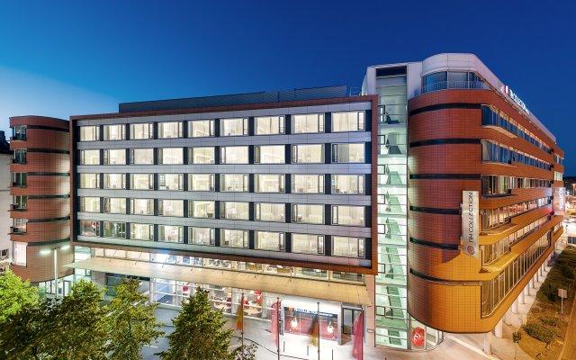 Отель NH Collection Frankfurt City вид на фасад