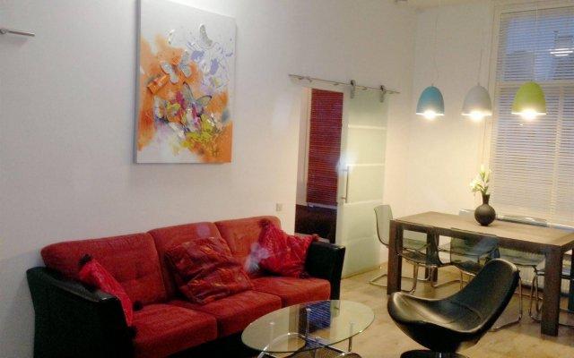 Апартаменты Flower Market Apartments комната для гостей