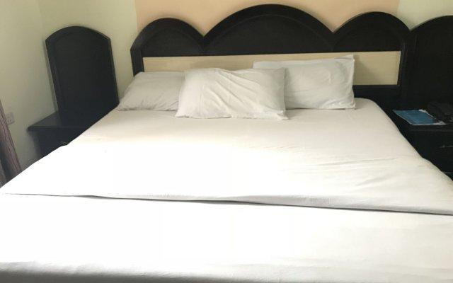Отель PennyHill Suites and Resorts Нигерия, Энугу - отзывы, цены и фото номеров - забронировать отель PennyHill Suites and Resorts онлайн комната для гостей