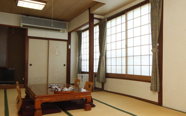 Отель Houraikan Япония, Минамиогуни - отзывы, цены и фото номеров - забронировать отель Houraikan онлайн удобства в номере
