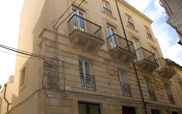 Отель Lemòni Suite Сиракуза вид на фасад