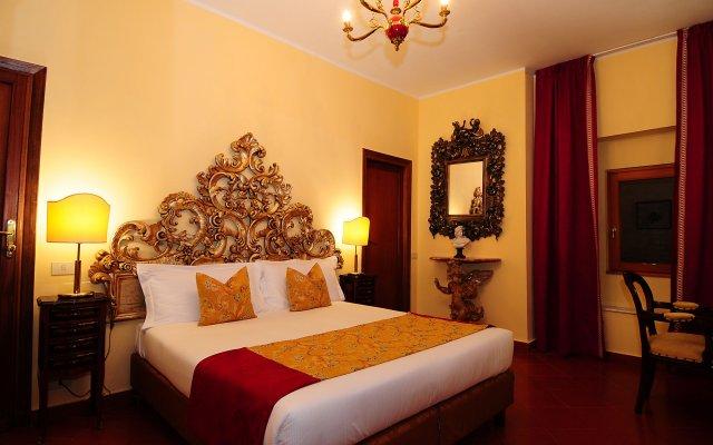 Отель Circo Massimo Exclusive Suite комната для гостей