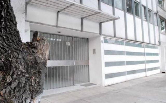 Отель Suites Churubusco Мехико вид на фасад