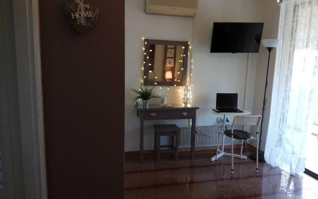 Отель Top floor cozy apartment near the beach Греция, Вари-Вула-Вулиагмени - отзывы, цены и фото номеров - забронировать отель Top floor cozy apartment near the beach онлайн комната для гостей