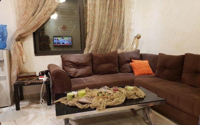 Отель Abdoun Hills Apartment Иордания, Амман - отзывы, цены и фото номеров - забронировать отель Abdoun Hills Apartment онлайн комната для гостей