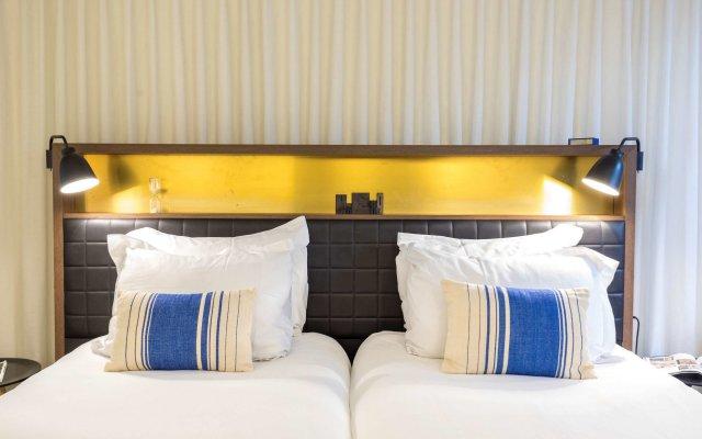 Отель Ink Amsterdam Амстердам комната для гостей