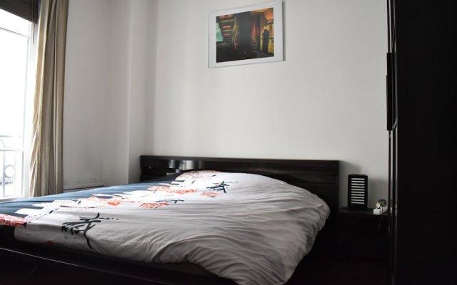 Апартаменты Simplistic 1 Bedroom Apartment in 17th комната для гостей