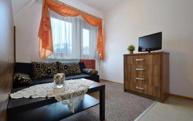 Отель Apartamenty i Pokoje Gościnne DZIEDZIC Józef Закопане комната для гостей