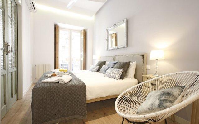 Отель Reina Sofia Boutique - Madflats Collection Мадрид комната для гостей