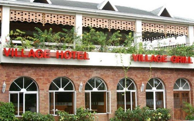 Отель Village Hotel Ямайка, Очо-Риос - отзывы, цены и фото номеров - забронировать отель Village Hotel онлайн вид на фасад
