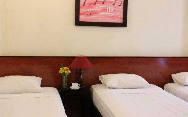 Отель Nhi Trung Hotel Вьетнам, Хойан - отзывы, цены и фото номеров - забронировать отель Nhi Trung Hotel онлайн вид на фасад